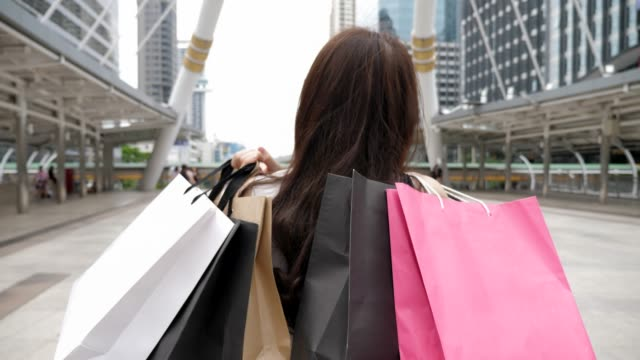 shopping:woman with shopping bags - shopping bag stock videos and b-roll footage