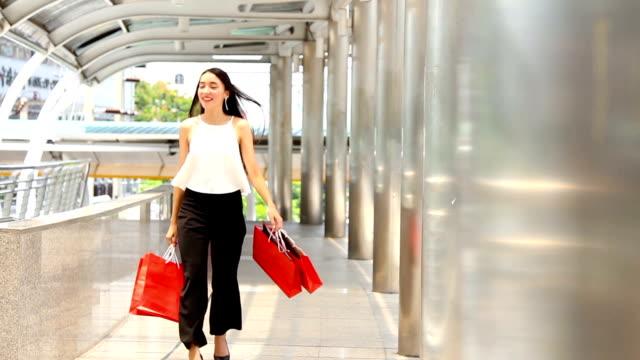 SEA: Shopping:Woman with Shopping Bags.HD format.