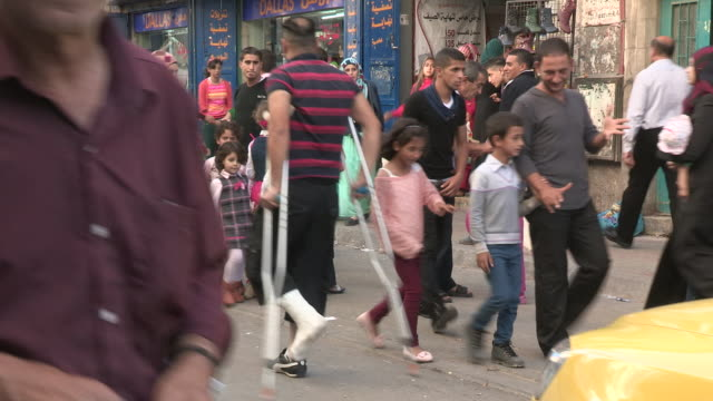shops and pedestrians, bethlehem, palestine - palestinian territories stock videos and b-roll footage