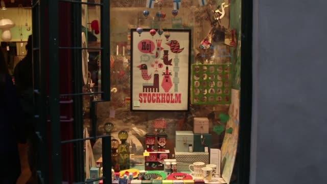 shops and small businesses in stockholm sweden on october 7 close up of a made in sweden sign in a store display close ups of a women handing a... - kassörska bildbanksvideor och videomaterial från bakom kulisserna