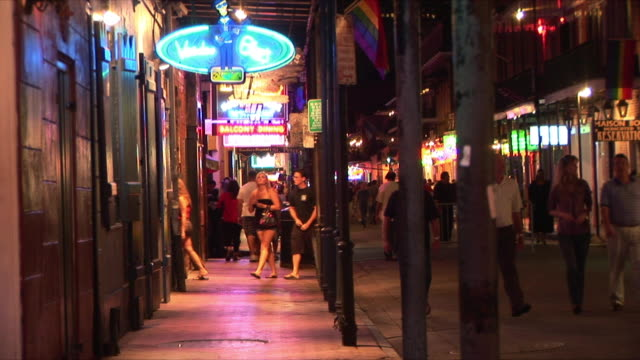WS Shops and tourists on Bourbon Street at night, French Quarter, New Orleans, Louisiana, USA