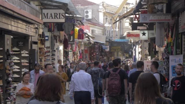 shops and visitors in flea market in monastiraki district, athens, greece, europe - waist up stock videos & royalty-free footage