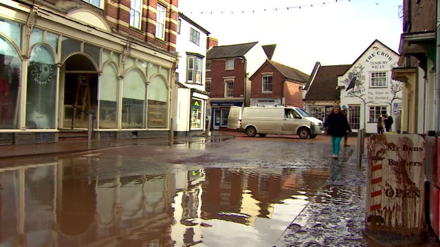 shops cleaning up after flooding in tenbury wells worcestershire after storm dennis - mud stock videos & royalty-free footage