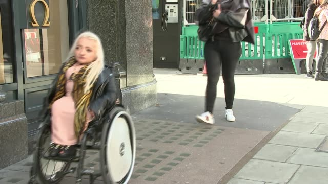 shops encouraged to improve access for disabled people on purple tuesday; uk, london, oxford street; reporter samantha renke along in wheelchair past... - international landmark stock videos & royalty-free footage