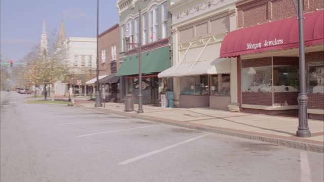 ds shops in downtown area of small town / georgia, united states - small town stock videos & royalty-free footage