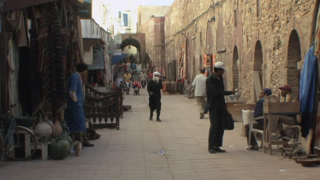 ws shops in medina along old city walls, essaouira, morocco - old town stock videos & royalty-free footage