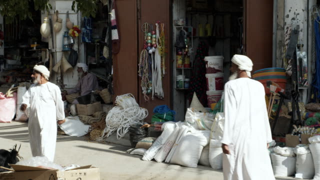 ms shops in souk, bahla, oman - dish dash stock videos & royalty-free footage