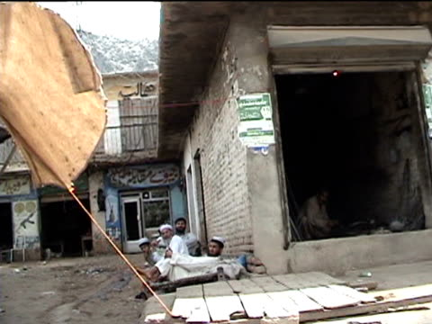 shops in street darrah in swat agency of tribal zones federally administered tribal areas pakistan audio - ladenschild stock-videos und b-roll-filmmaterial