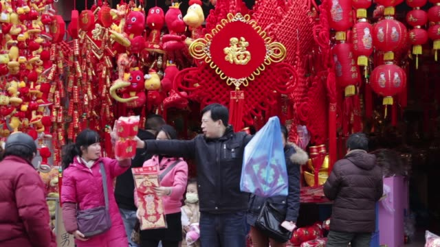 shops selling chinese new year decorations in shanghai shopping district in shanghai on february 02 2013 in shanghai china - decoration stock videos & royalty-free footage