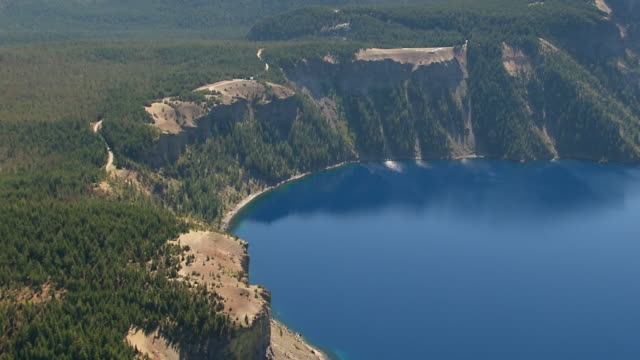 ws aerial shore and inside wall of crater at crater lake / oregon, united states - crater lake oregon stock videos & royalty-free footage