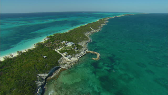 aerial shoreline of rose island, bahamas - bahamas stock videos and b-roll footage