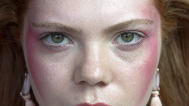 A short close-up film about a red haired young woman
