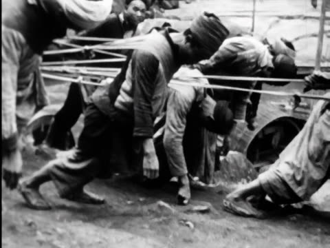 a short documentary on life and conditions in late 1940's shanghai - cart stock videos & royalty-free footage