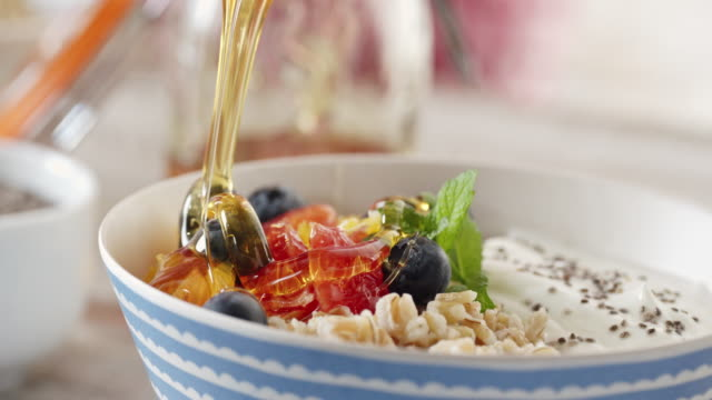 short grained rice with yoghurt and fresh fruits - antioxidant stock videos & royalty-free footage