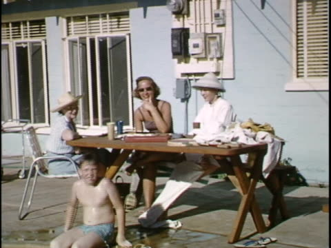 short home movie of a family's evening at the pool - standing water yard stock videos & royalty-free footage