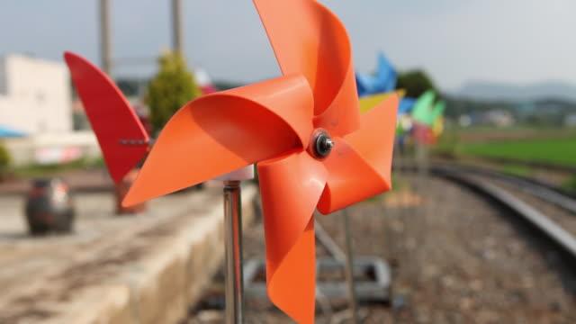 short of turning pinwheel at asan rail bike track - girandola video stock e b–roll
