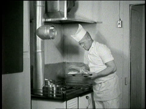 a short order cook grills meat and peels potatoes - anno 1960 video stock e b–roll