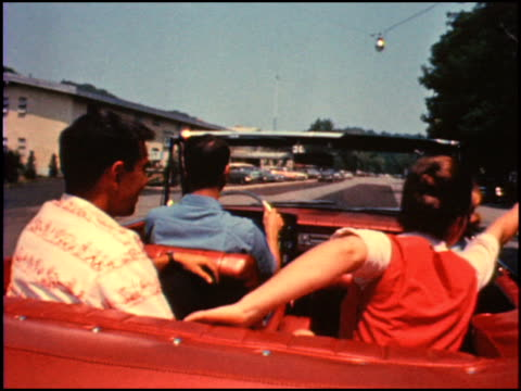 stockvideo's en b-roll-footage met / short promotional film for the 1964 studebaker daytona convertible / two young couples on vacation explore saugatuck, michigan in their studebaker... - chassis