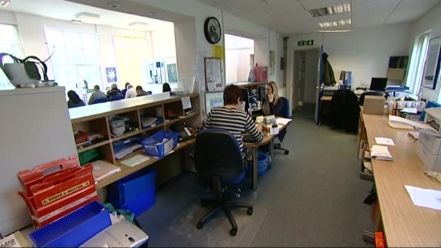 GP shortage putting patients at risks says senior doctor T14041419 / TX Brighton Receptionists sitting at desks in doctor's surgery Receptionist on...
