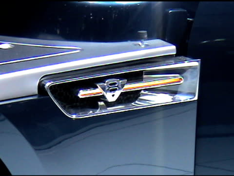 ws front end of ford interceptor shaker hood rises automatically as car revolves on turntable / shot 2 ms of ford racing 50 liter cammer engine under... - back to front stock videos and b-roll footage