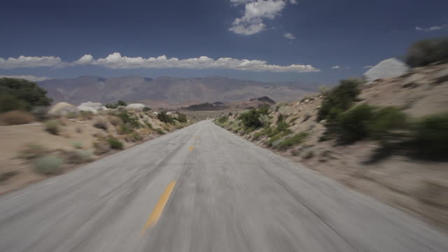 POV shot along a road in Death Valley, Eastern California.