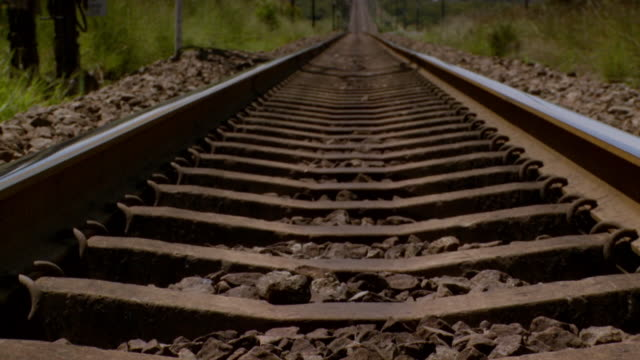 cu pov shot along train track / south africa - railway track stock videos & royalty-free footage