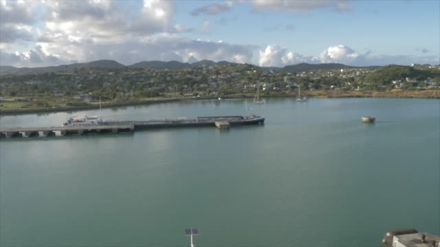 shot approaching st. john's from moving cruise ship, antigua, antigua and barbuda,  caribbean sea, west indies, caribbean, central america - john harding stock videos and b-roll footage