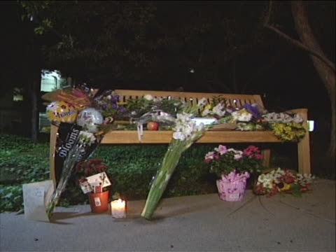 shot begins on cu of an apple and widens to show a bench outside apple headquarters where people are leaving flowers and candle in memory of apple... - walt disney animation studios stock videos & royalty-free footage
