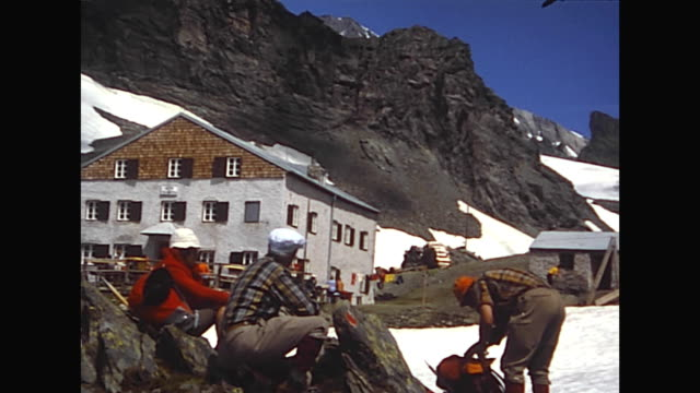 """vidéos et rushes de shot between 1975 and 1985, alpinists walking the way to the alpine hut """"stüdlhütte"""", passing snowfields and flowers, different views to the... - autriche"""
