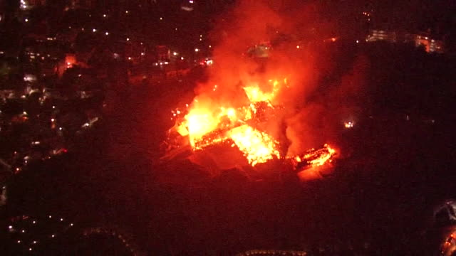 stockvideo's en b-roll-footage met october 31 2019 location naha city okinawa prefecture japan shot list aerial shot of fire at shuri castle description a fire is raging at shuri... - ontslaan