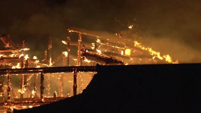 stockvideo's en b-roll-footage met october 31 2019 location naha city okinawa prefecture japan shot list a fire is raging at shuri castle description a fire is raging at shuri castle a... - ontslaan