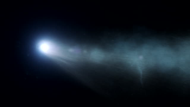 cgi shot focusing on the tail of comet ison as it flies through space. - 光点の映像素材/bロール
