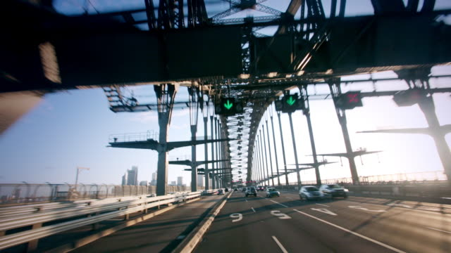 pov shot from a car as it travels across the sydney harbour bridge. - point of view stock videos and b-roll footage