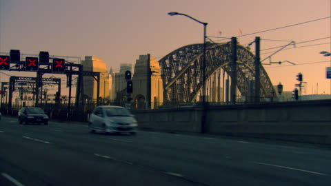 pov shot from a car as it travels towards the sydney harbour bridge. - car point of view stock videos & royalty-free footage