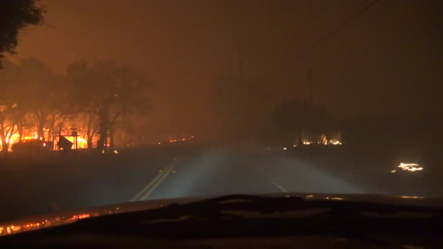 shot from a car driving down a road through the kincade wildfire in geyserville, california. - produced segment stock videos & royalty-free footage