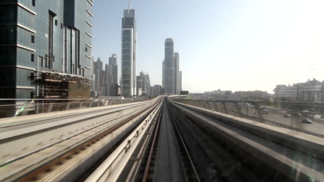 POV shot from a front of a train as it travels across the city of Dubai.