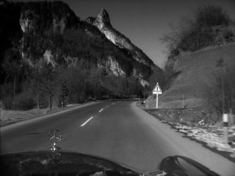 shot from a mercedes car as it drives along a road in the bavarian countryside. - baviera video stock e b–roll
