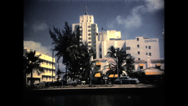 "shot from a moving car of hotels and palm trees; building with the words ""continental"" - miami stock videos & royalty-free footage"