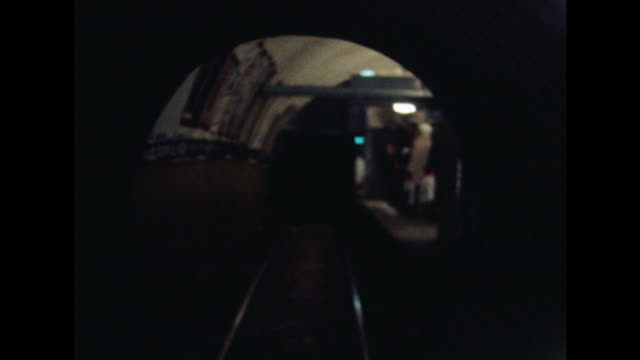 POV shot from a train as it arrives at a station on Glasgow's underground railway system