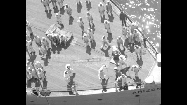 vidéos et rushes de shot from above of aerial balloon about to be launched from stern of battleship arizona tilt down to sailors and officers moving about on deck / shot... - marin