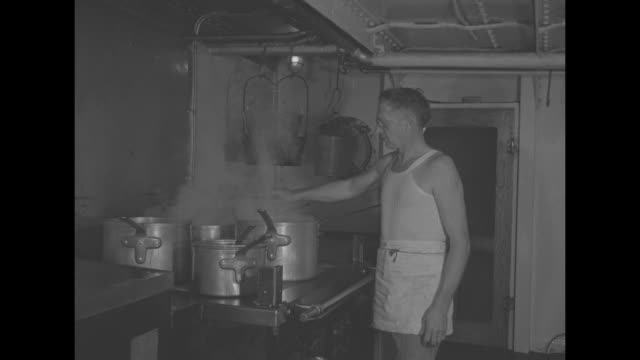 shot from above of sailor climbing rapidly down ladder inside tanker / two shots of sailors preparing food in galley / two shots of sailors in mess... - galeere stock-videos und b-roll-filmmaterial