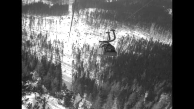 shot from above of structure at bottom end of ski lift / ground level shot of structure at bottom end of ski lift / shot from gondola going up on ski... - seggiovia video stock e b–roll