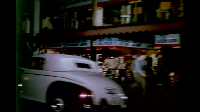 shot from automobile along 8th street / nighttime streets of downtown / stores theaters and marquees pedestrians on sidewalk traffic downtown at... - 1946 stock-videos und b-roll-filmmaterial