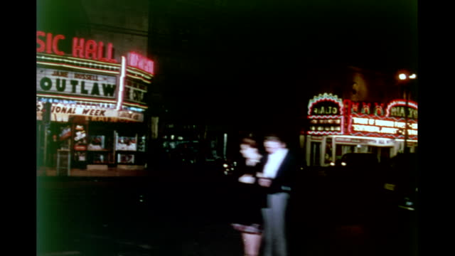 stockvideo's en b-roll-footage met shot from automobile along 8th street / nighttime streets of downtown / stores theaters and marquees pedestrians on sidewalk traffic downtown at... - 1946