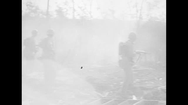 shot from behind us marines as they walk across field behind tanks / ws marines walking along road explosion near road / marines advancing / line of... - us marine corps stock videos & royalty-free footage