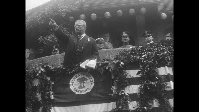 shot from below of roosevelt on stage speaking at forest hills gardens rail station in new york city on 7/4/1917 / title card title / note exact year... - theodore roosevelt us president stock videos & royalty-free footage