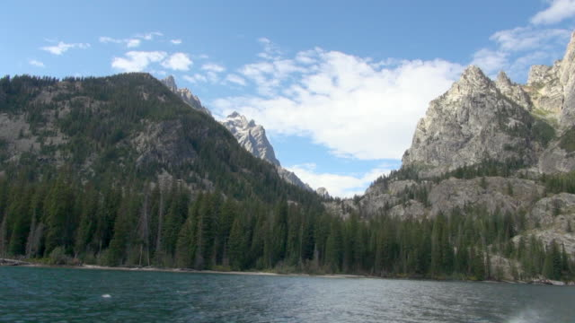 shot from boat of big mountains of grand teton national park - grand teton national park stock videos & royalty-free footage