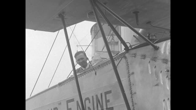 shot from boat of ocean liner sailing along / pilot sitting in cockpit of plane on catapult ramp plane's propeller spinning / closer shot of pilot in... - boat ramp stock videos & royalty-free footage