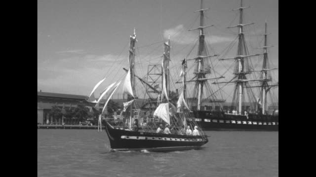 shot from boat of replica sailing along / replica sailing under raised drawbridge / shot from boat of replica sailing toward actual constitution tied... - drawbridge stock videos and b-roll footage