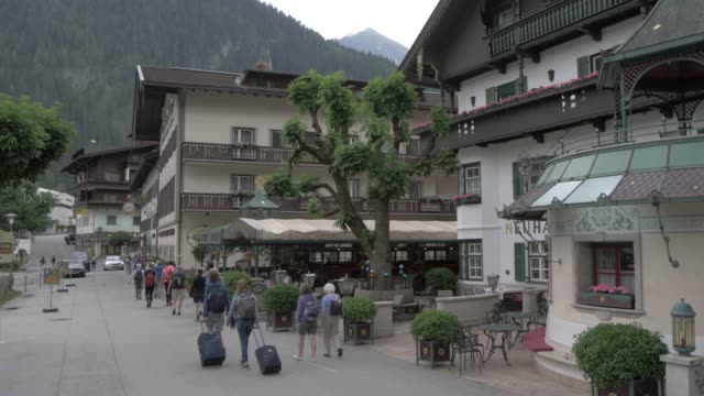 shot from car of hotels and hikers in mayrhofen, tyrol, austrian alps, austria, europe - north tirol stock videos & royalty-free footage